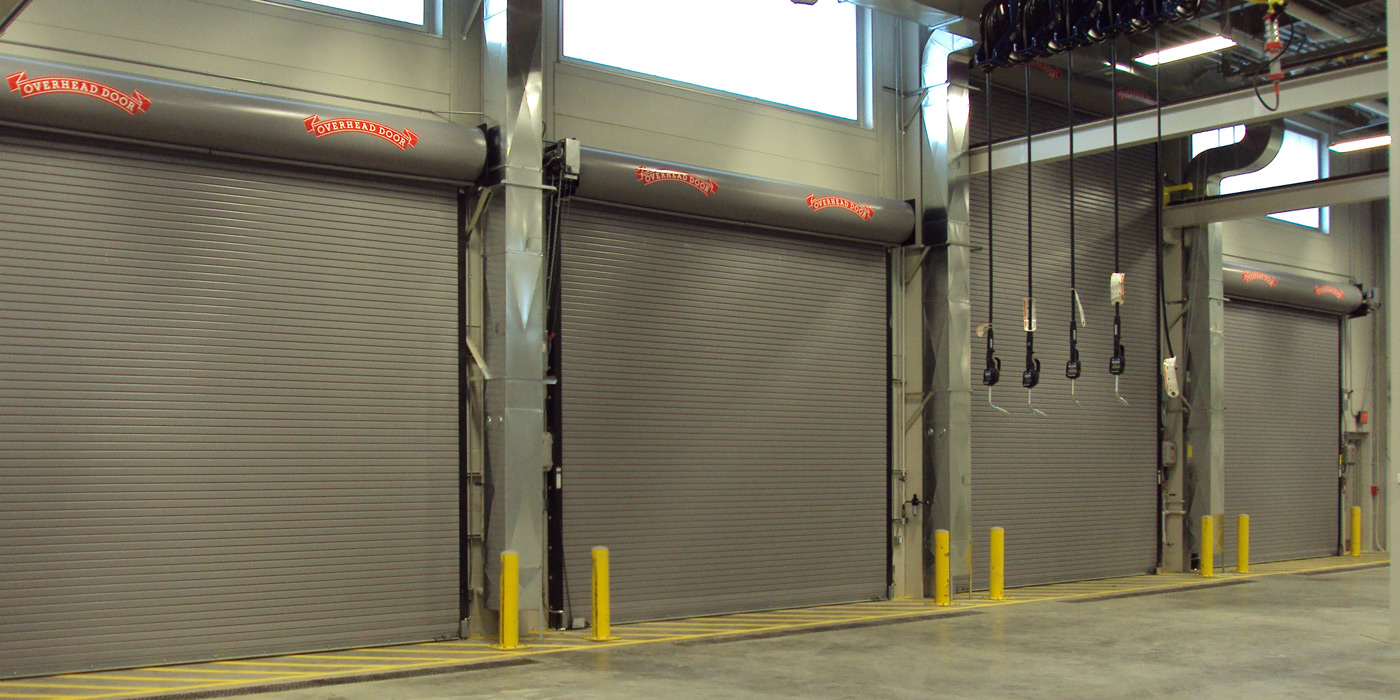 airport insulated spokane garage door steel overhead commercial doors clopay polyurethane